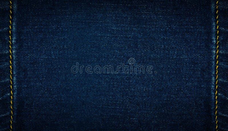 Vaqueros del tejano azul oscuro, fondo fotografía de archivo libre de regalías