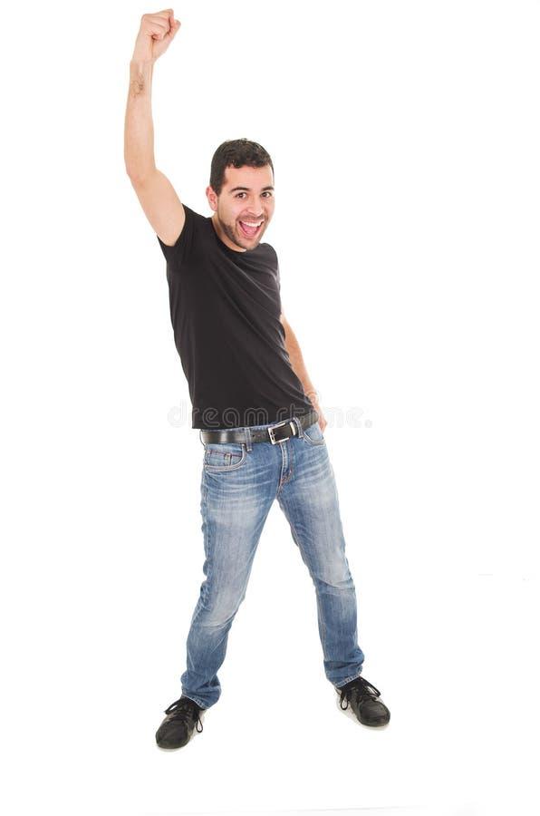 Vaqueros que llevan del hombre joven que presentan con el puño para arriba imagenes de archivo