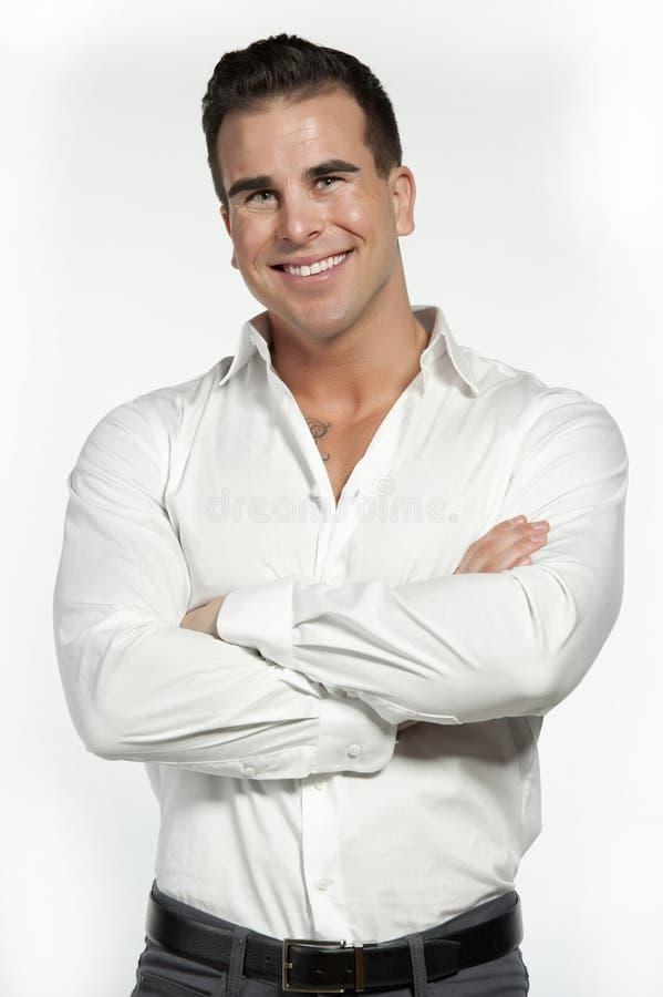Varón atlético en camisa cabida blanco foto de archivo libre de regalías