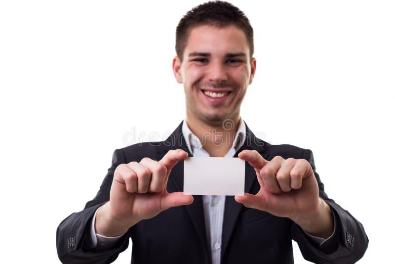 Varón joven con la tarjeta de visita vacía foto de archivo libre de regalías