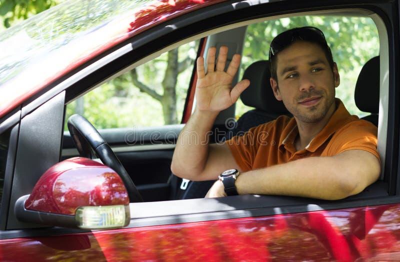 Varón joven en coche foto de archivo libre de regalías