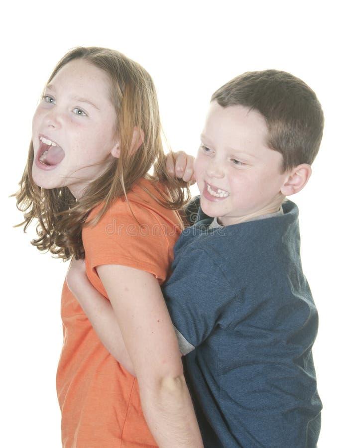 vara barn för pojkeflickatest royaltyfri fotografi