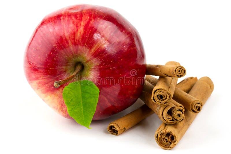 Vara de canela com maçã foto de stock