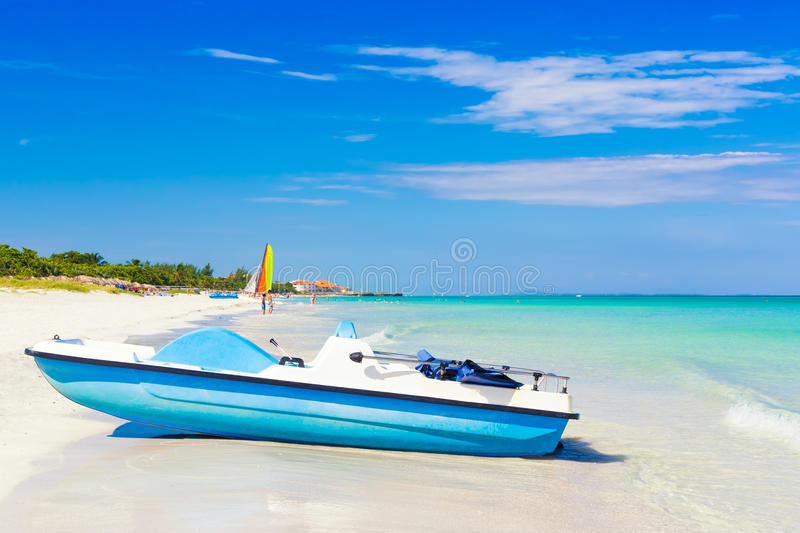 Varadero beach in Cuba with a paddle boat royalty free stock photography