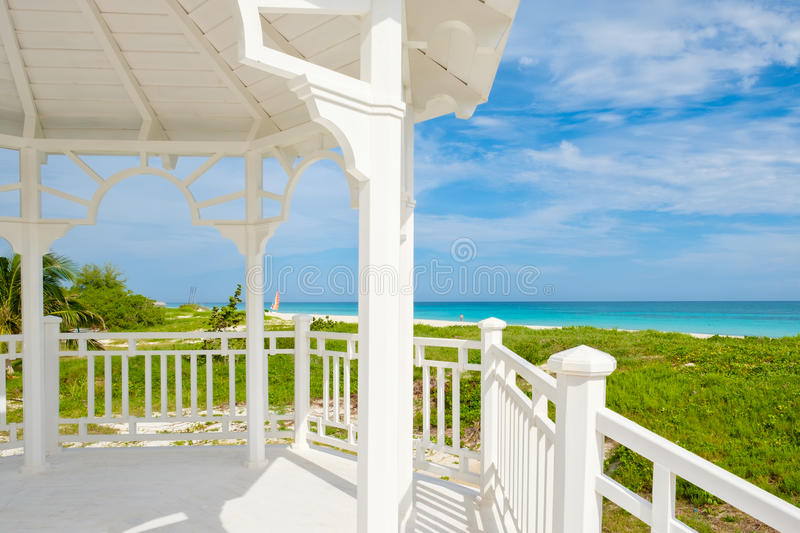 Varadero beach in Cuba seen from the windows of a white seaside wooden pavilion royalty free stock images