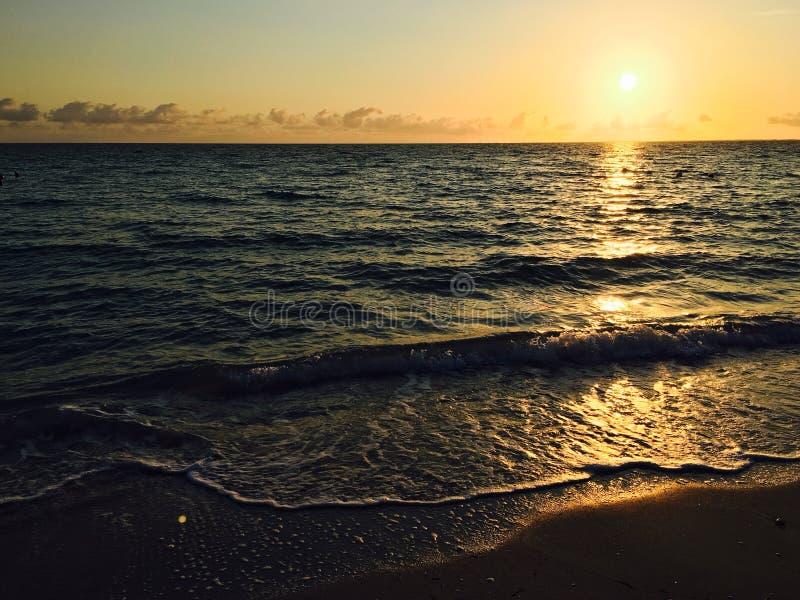 Varadero beach at sunset. Varadero, Cuba beach front at sunset with light reflecting on the water surface stock photo