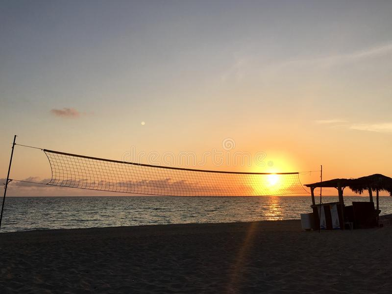 Varadero beach at sunset. Varadero, Cuba beach front at sunset through beach volleyball net stock images