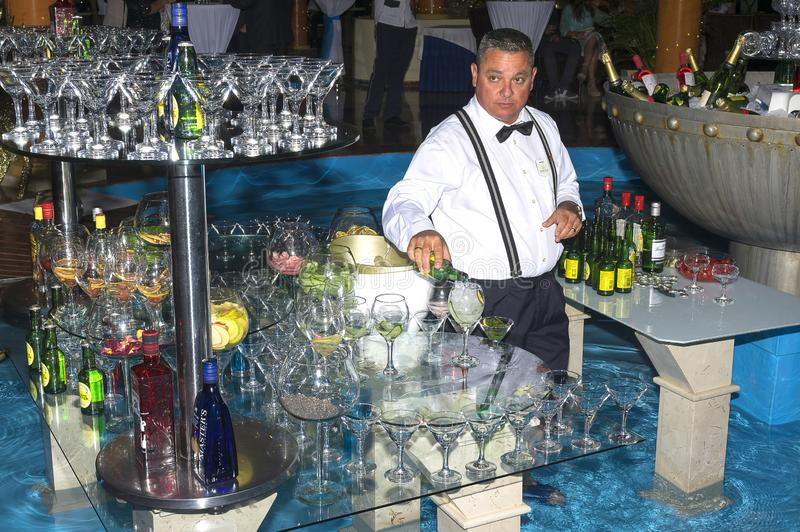 Varadero, Cuba - December 31, 2017: he barman at the hotel in Cuba on New Year`s Day serves the guests royalty free stock images