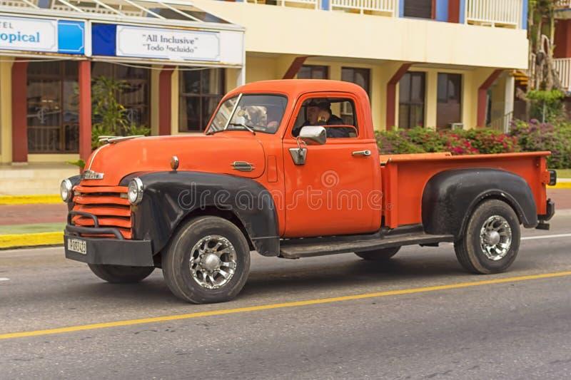 VARADERO, CUBA - JANUARY 05, 2018: Classic orange Chevrolet retro car rides on the road of Varadero in Cuba stock photo