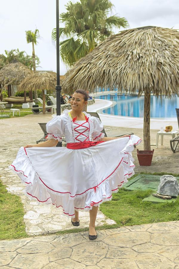 VARADERO, CUBA - JANUARY 05, 2018: Girl in national dress posing stock photography
