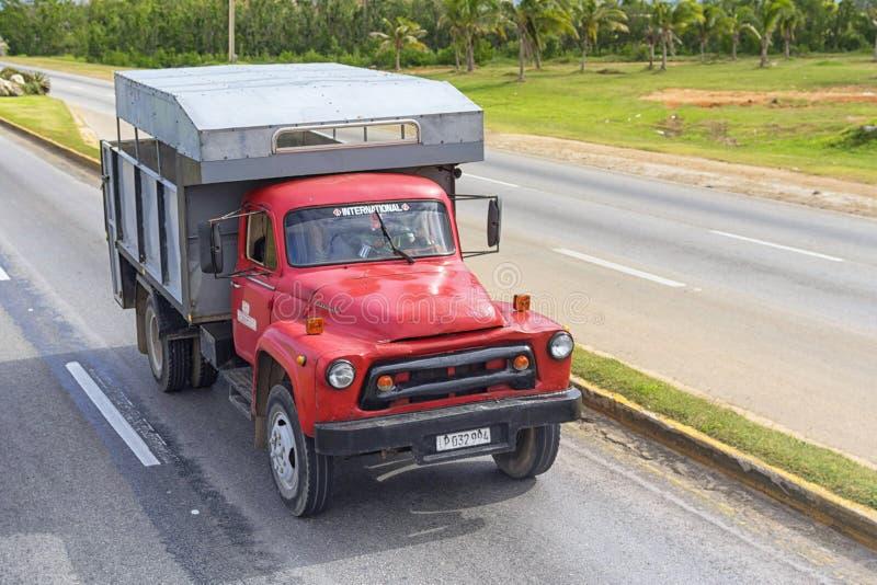 VARADERO, CUBA - JANUARY 05, 2018: Red truck rides on the road of Varadero in Cuba stock photo