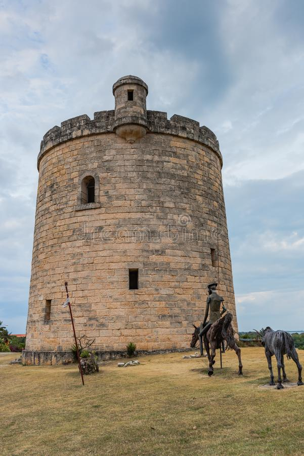 Quixote Castle Tower. Varadero, Cuba / March 19, 2016: Castle tower and statue of Don Quixote Quijote in Varadero, Cuba royalty free stock photography
