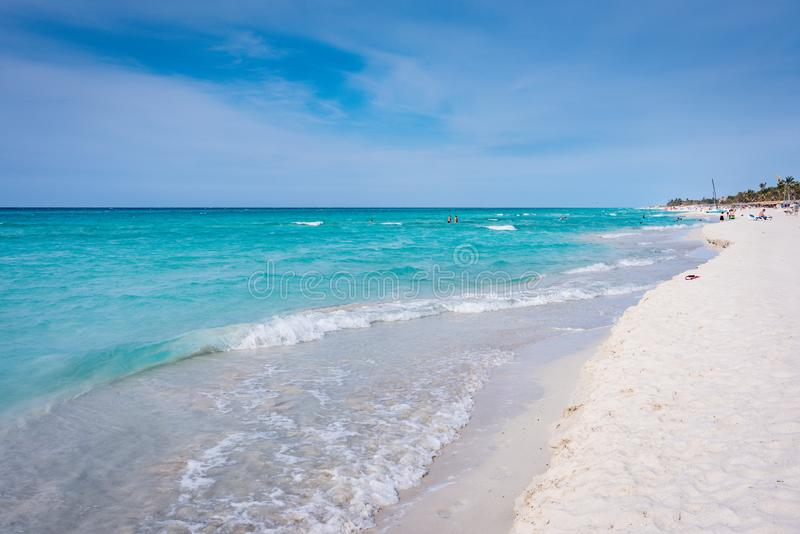 Quiet Stretch of Varadero Beach. Varadero, Cuba / March 17, 2016: Although the resort areas may be crowded with sunbathers, much of the long Varadero Beach royalty free stock photography