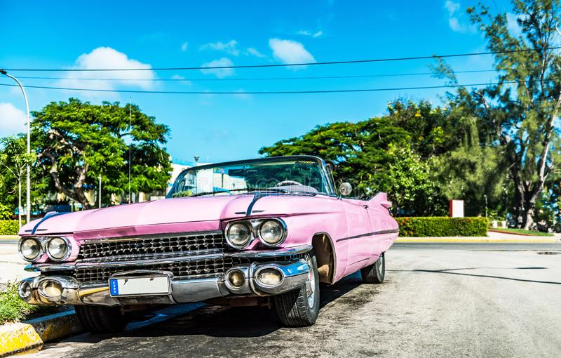 HDR - American pink convertible vintage car in the front view in Varadero Cuba - Serie Cuba stock photo