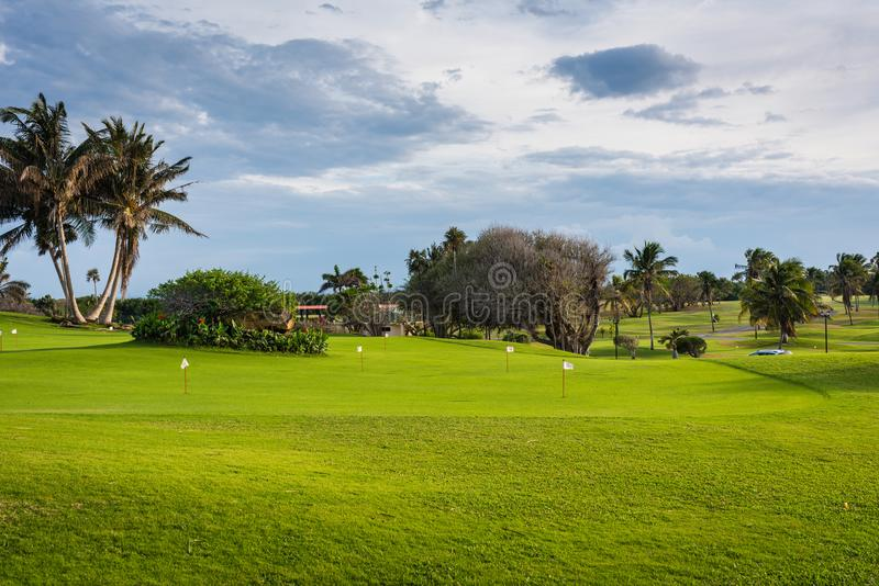 Varadero Golf Club Lawn. Varadero, Cuba / March 19, 2016: Green lawn and holes at Varadero Golf Club, the only 18 hole Golf Course in Cuba stock image