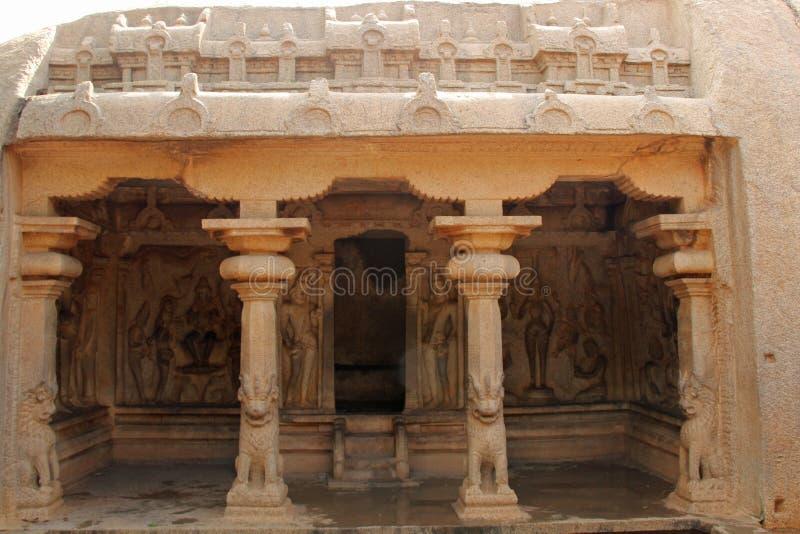The Varaha Cave Temple. Varaha Cave Temple also Adivaraha Cave Temple is a rock-cut cave temple located at Mamallapuram, on the Coromandel Coast of the Bay of royalty free stock image