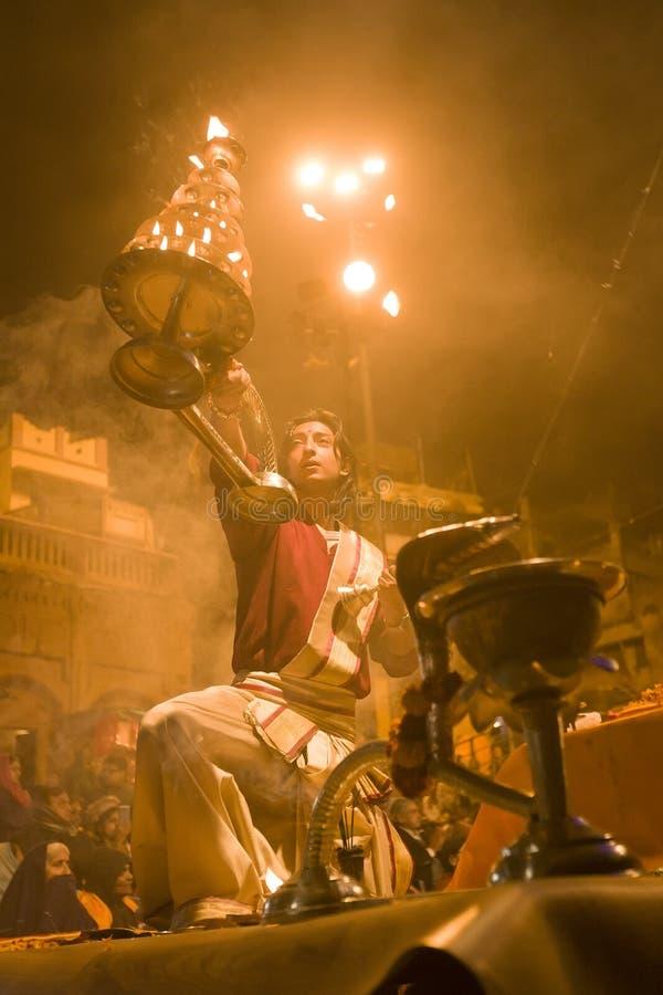 VARANASI, INDIA – DEC, 2015: A Holy Banares Ghats. An unidentified Hindu priest performs religious Ganga Aarti ritual royalty free stock image