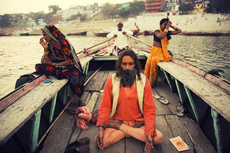 VARANASI INDIA 8 FEB 2013 :sadhu sitting on the boat in Ganga river varanasi india royalty free stock photo
