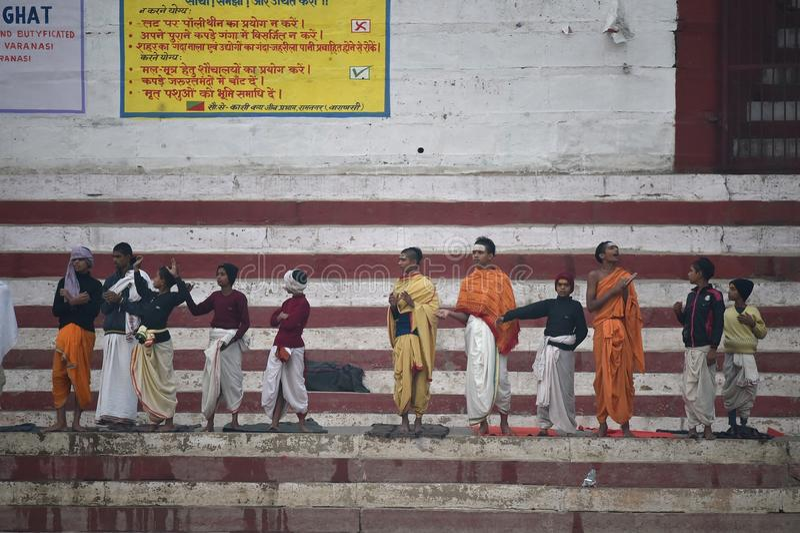 Varanasi, India, November 26, 2017: Young boys having religious ritual stock photography