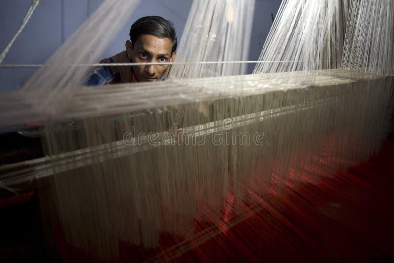 Varanasi. India - Varanasi - A silk seller stock photography