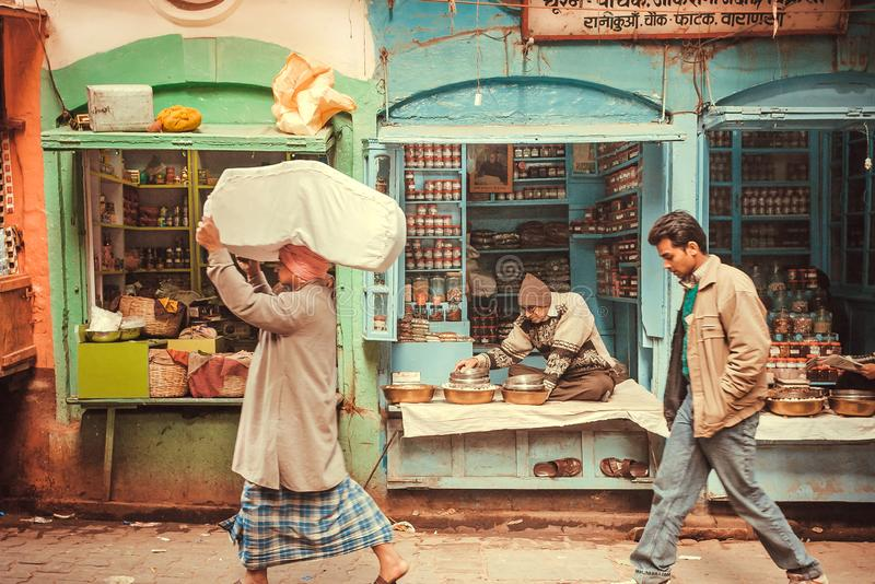Traders and customers of street market with local spices shops and grocery stores stock photography