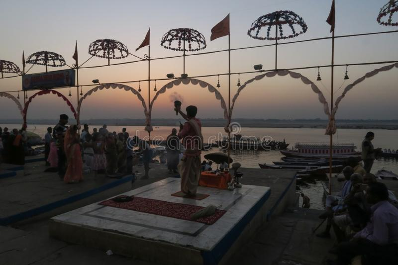 Prayer doing a ceremony at the border of the river of Ganges in Varanasi stock photo