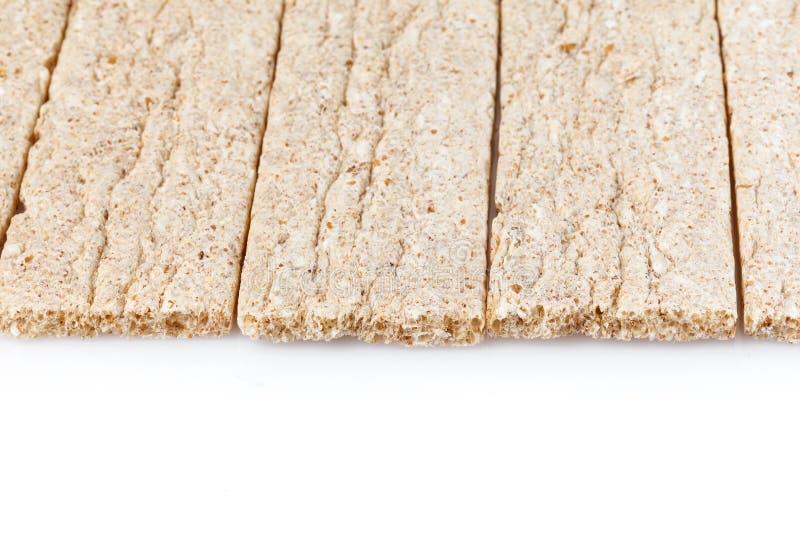 Varas de pão secas dietéticas Isolado no fundo branco Dieta e alimento natural e petisco imagens de stock
