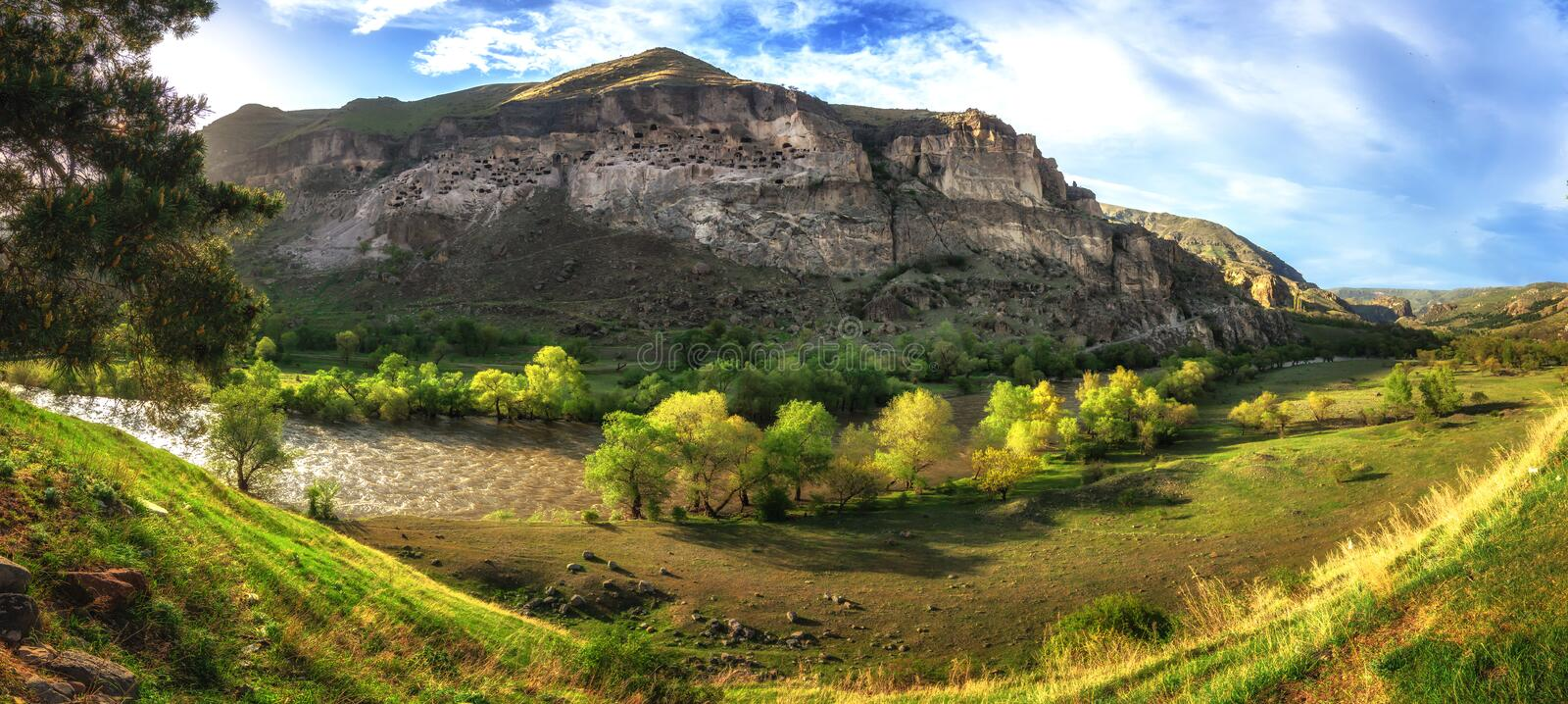 Vardzia cave monastery and ancient city in mountain rocks, Georgia. Main attraction. Panoramic view stock photography