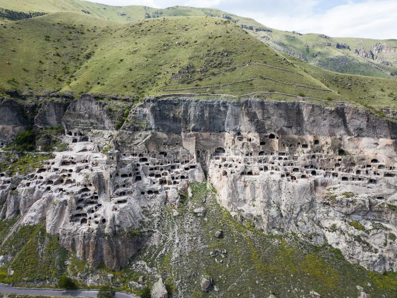 Vardzia is a cave monastery site excavated from Erusheti Mountain on the left bank of the Mtkvari River, near Aspindza. Aerial view to Vardzia cave monastery stock photos