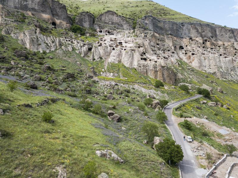 Vardzia is a cave monastery site excavated from Erusheti Mountain on the left bank of the Mtkvari River, near Aspindza. Aerial view to Vardzia cave monastery stock image