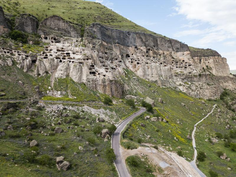 Vardzia is a cave monastery site excavated from Erusheti Mountain on the left bank of the Mtkvari River, near Aspindza. Aerial view to Vardzia cave monastery royalty free stock photos