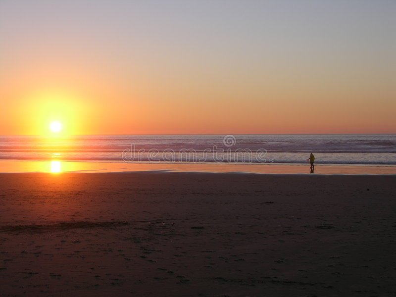 Vare la puesta del sol de la playa fotografía de archivo libre de regalías