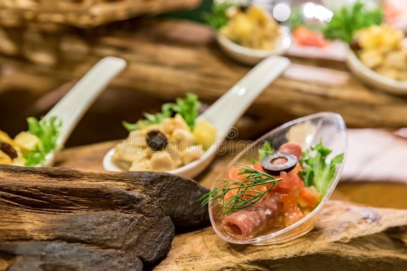 Canape on spoon royalty free stock image