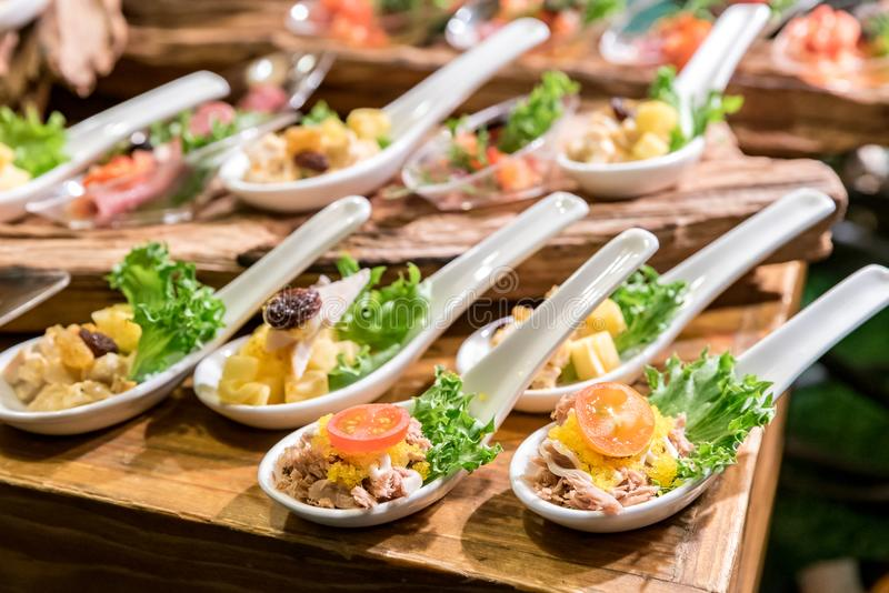 Canape on spoon stock photo