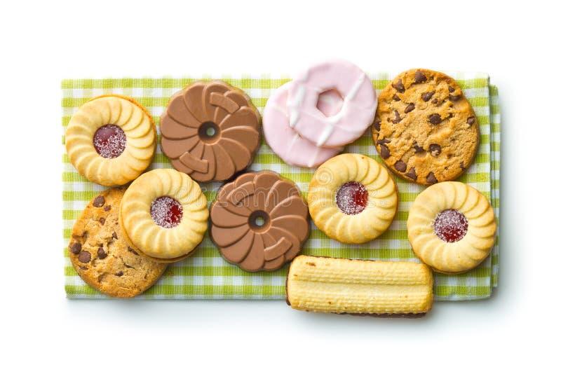 Vari biscotti dolci sul tovagliolo a quadretti immagini stock libere da diritti