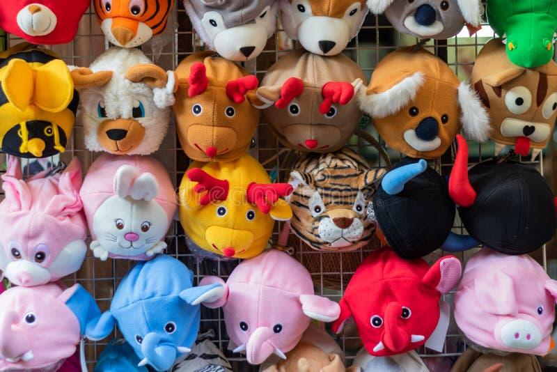 Vari cappelli a forma di animali immagini stock libere da diritti