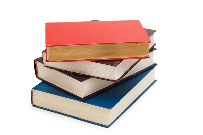 Vari libri isolati sui precedenti bianchi immagine stock libera da diritti
