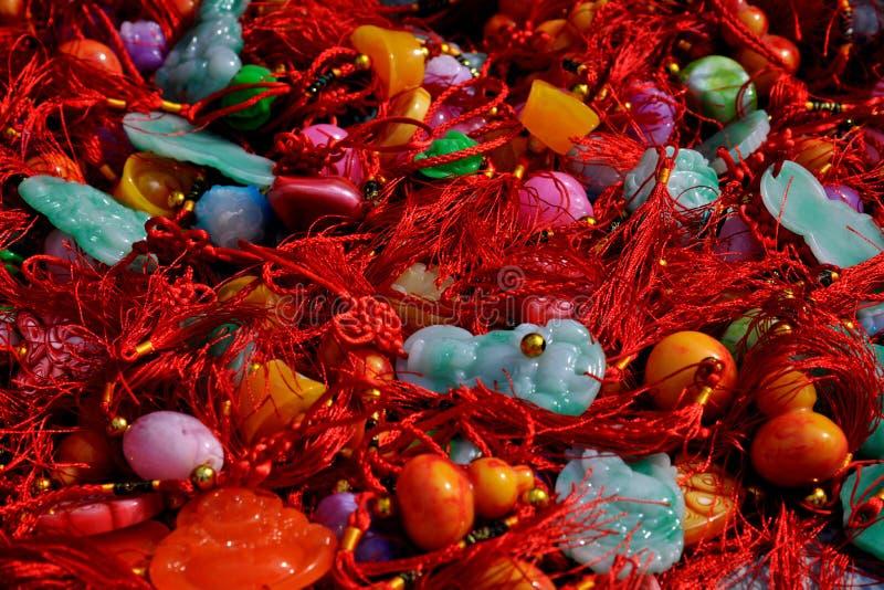 Vari ornamenti della giada degli artigianato fotografie stock