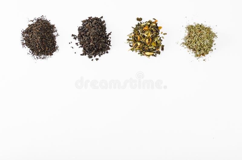 Varias clases de hojas de té ennegrecen diverso fondo blanco de la colección verde fotos de archivo libres de regalías