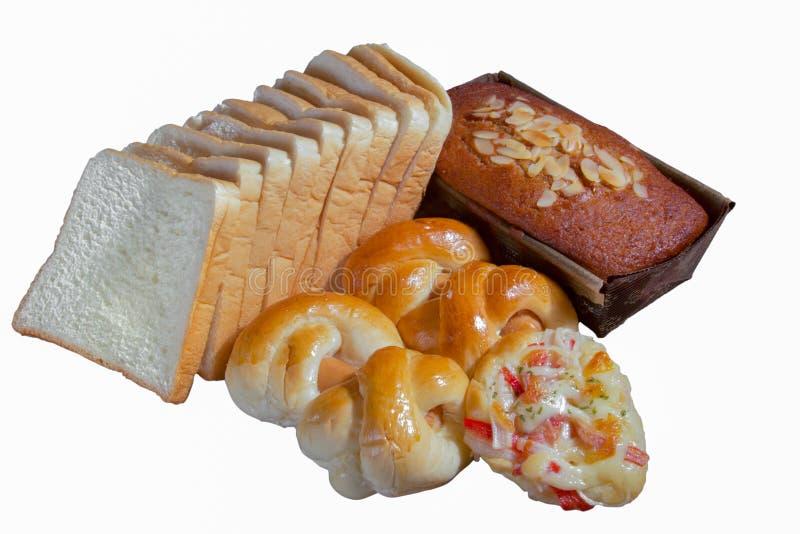 Variation av bröd och kakan arkivfoto