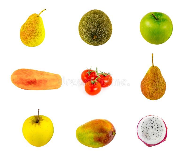 Variation av ett te och en mango för halv liter för äpple för exotiska tomater för frukter för frukter röda den saftiga halvan på royaltyfri foto