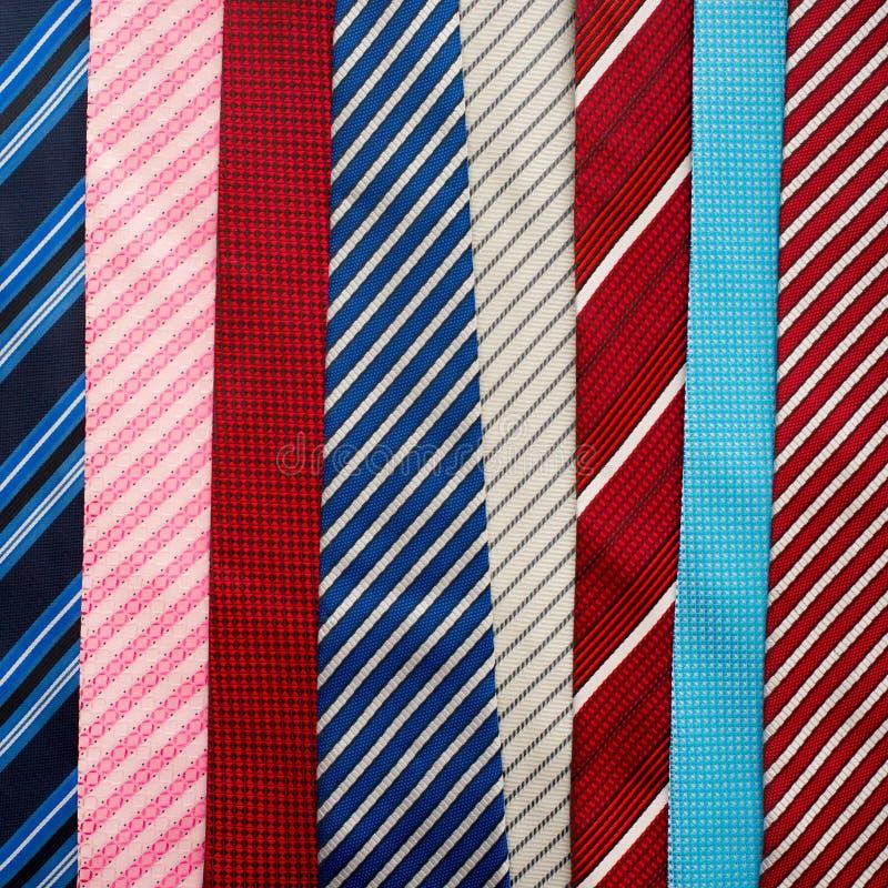 Variation av färgrika slipsar royaltyfria bilder
