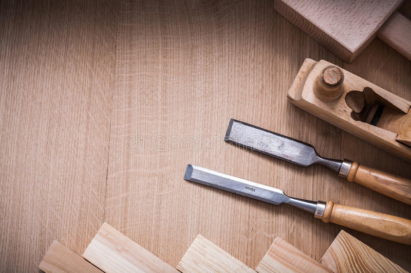 Variation of woodworker's working tools on wood. Board construction concept royalty free stock photo