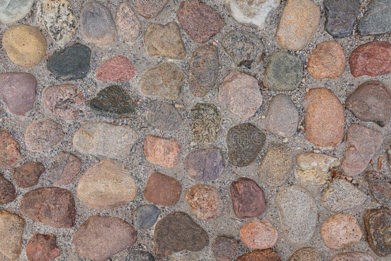 Varicolored granite stones walkway, pattern seamless, texture. Red Granite stones walkway, pattern seamless texture royalty free stock images