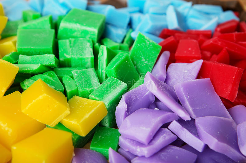 Varicoloured pieces of beeswax to make candle royalty free stock images