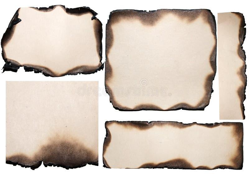 Varie parti strappate di vecchio documento bruciato fotografia stock