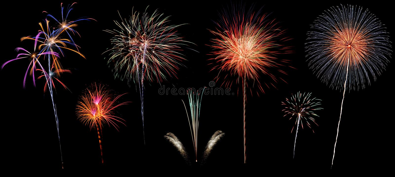 Variedad de fuegos artificiales coloridos aislados en fondo negro imagen de archivo libre de regalías