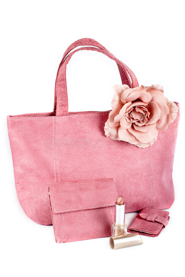Variedade de bolsas e do batom cor-de-rosa fotografia de stock royalty free