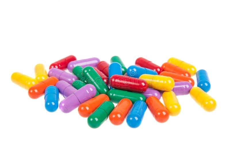 Variedade de comprimidos coloridos isolados foto de stock royalty free