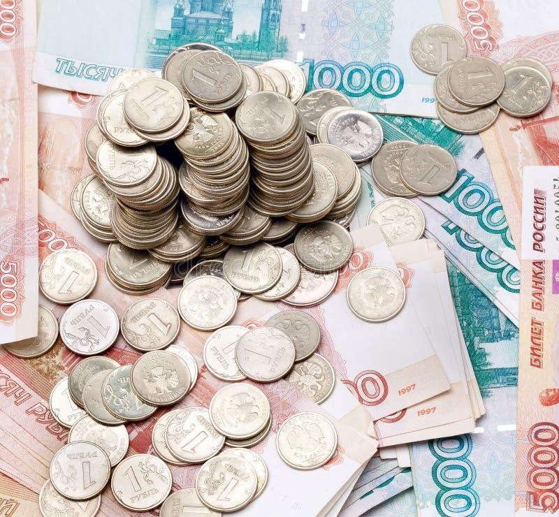Variedade de moedas e de notas de banco fotos de stock